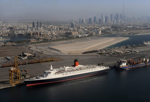 The Queen Elizabeth 2 berthed at Port Rashid close to Dubai Creek, Dubai. The ship was brought to Dubai to be turned into a floating hotel but the project appears to be on hold for the moment and the only sign of activity is a wisp of smoke from the funnel where the engines are kept turning over from time to time to keep air circulating. Pic: Keith Waldegrave           see story Amanda Perthen